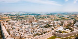Aerial view of the fortified capital city of Malta. The Silent City, Mdina or L-Imdina, skyline against blue Spring skies with huge walls, cathedral domes and Stock Photo