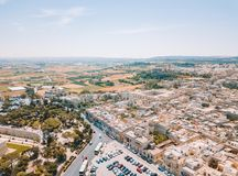Aerial view of the fortified capital city of Malta. The Silent City, Mdina or L-Imdina, skyline against blue Spring skies with huge walls, cathedral domes and Stock Photography