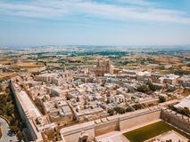 Aerial view of the fortified capital city of Malta. The Silent City, Mdina or L-Imdina, skyline against blue Spring skies with huge walls, cathedral domes and Stock Images