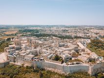 Aerial view of the fortified capital city of Malta. The Silent City, Mdina or L-Imdina, skyline against blue Spring skies with huge walls, cathedral domes and Royalty Free Stock Photography