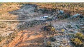 Aerial view of four wheel drive vehicle and large caravan camped. Just after sunrise in the outback of Australia Stock Photo