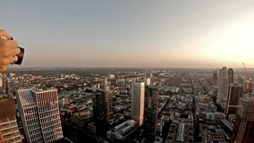 Aerial view of the Frankfurt - Main skyline in Germany - Lady shows camera to take a picture.  stock video