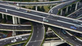 Aerial View of freeway busy city rush hour heavy traffic jam highway. Aerial View of freeway busy city rush hour heavy traffic jam highway,shanghai Yan'an East stock footage