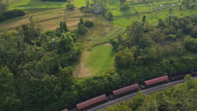 Aerial: view of a freight train crossing the stone railroad bridge stock video footage