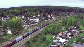 Aerial view on freight train goes through the bridge. train or freight train goes on rails view from sky. View on. Freight train rides on the tracks near forest stock footage