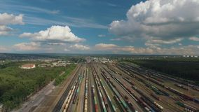 Aerial view of freight train at the railway station, transport hub. Logistics, transportation, delivery of goods. Shooting on a sunny day. Railway and light stock video