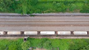 Aerial view freight trains in railway station. Cargo trains wagons on railroad, top down. Heavy industry conceptual, rail track in. Industrial district stock photos