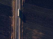 Aerial view of freight transportation truck on the road. Through countryside Royalty Free Stock Photography