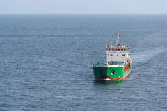 Aerial view of a freighter sailing at the blue sea Royalty Free Stock Photos