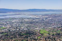 Aerial view of Fremont and Newark on the shoreline of east San Francisco bay area. Dumbarton bridge in the background; Silicon Valley, California royalty free stock photography
