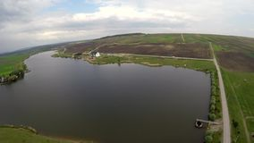 Aerial view of a fresh water lake . This video was captured using a drone stock footage