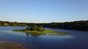 Aerial View of Freshwater Lake on Cape Cod, MA. Aerial view of the peaceful, summerl scenery in a freshwater lake on Cape Cod, Massachusetts. This peninsula has stock video footage