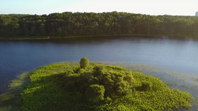 Aerial View of Freshwater Lake on Cape Cod. Aerial view of the peaceful, summerl scenery in a freshwater lake on Cape Cod, Massachusetts. This peninsula has stock video footage