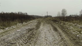 Aerial view of frozen dirty road in country side stock footage