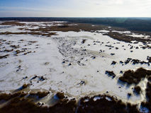 Aerial view of frozen forest lake in winter Stock Photos