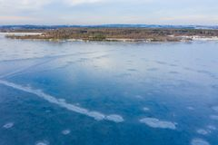 Aerial view of frozen lake. Winter scenery. Landscape photo captured with drone above winter wonderland stock photos