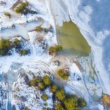 Aerial view of frozen lake. Winter scenery. Landscape photo captured with drone above winter wonderland royalty free stock images