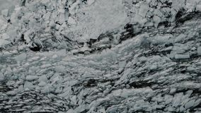 Aerial view of a frozen river. Fancy ice texture, cold chained water. Shards of ice stick out with sharp edges.