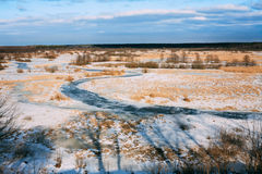 Aerial view of frozen river in sunny winter  day. Winter landscape. Aerial view of snowy forest and frozen river in sunny day Royalty Free Stock Photos