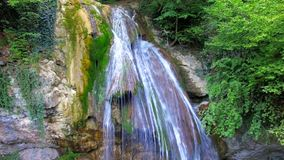 AERIAL VIEW. Full-Flowing Waterfall Dzhur Dzhur in stock video footage