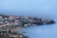 Aerial view of Funchal city and Praia Formosa beach. Madeira. Aerial view of Funchal city and black sand beach Praia Formosa. Portuguese island of Madeira stock image