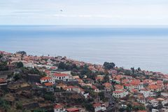 Aerial view at Funchal city and sea water, Madeira island. Aerial view at Funchal city and sea water from Monte on Portuguese island of Madeira royalty free stock images