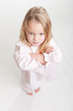 Aerial view of a furious blonde kid in her pajamas Royalty Free Stock Images