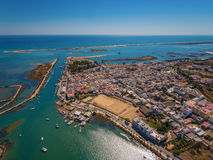 Aerial view of Fuzeta with coastline and docks, Royalty Free Stock Image