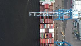 Aerial view of gantry crane loading and unloading ship stock video footage