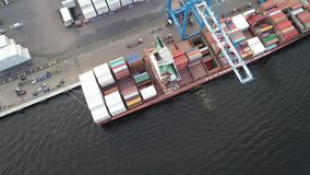 Aerial view of gantry crane loading and unloading ship stock video