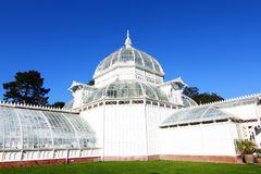 Golden Gate Park in San Francisco California. Aerial view of the garden of the Conservatory of Flowers, a greenhouse and botanical garden housing rare and exotic royalty free stock images
