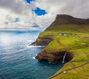 Aerial view of Gasadalur village and its waterfall in Faroe Islands, Denmark