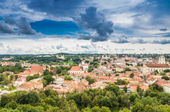Aerial view from Gediminas tower. Aerial view: Old town buildings visible from Gediminas tower under dark beautiful cloudy sky in Vilnius, Lithuania, country in royalty free stock photography