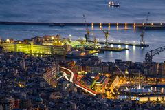 Aerial view of Genoa by night, the old town and harbor, Italy. Aerial view of Genoa, the old town and harbor / Genoa, Italy, Europe stock photo
