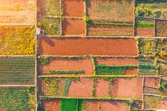 Free Aerial View Geometric Shapes Of Agricultural Parcels Of Different Crops In Green, Brown, Orange Colors Royalty Free Stock Photos - 150413348