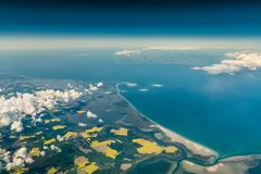 Aerial view of german peninsula Fischland-Darss-Zingst and island Hiddensee. Out of the cockpit from around 27.000 ft stock photography