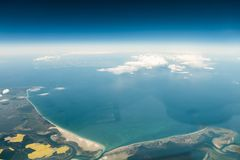Aerial view of german peninsula Fischland-Darss-Zingst and island Hiddensee. Out of the cockpit from around 27.000 ft stock image