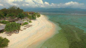 Aerial view of Gili Meno beach from drone with Lombok mountains in background. Aerial view of Gili Meno beach, Indonesia, from drone with Lombok mountains in stock footage