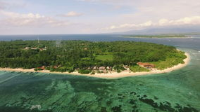 Aerial view of Gili Meno island from drone, Indonesia. Aerial view of Gili Meno island, Indonesia, from drone, fly back. Shot on sunny day with blue sky stock video footage