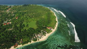 Aerial view of Gili Meno island from drone, Indonesia. Aerial view of Gili Meno island, Indonesia, from drone, fly back. Shot on sunny day with blue sky stock footage