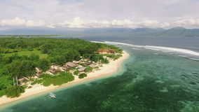 Aerial view of Gili Meno island from drone with Lombok mountains in background. Aerial view of Gili Meno island, Indonesia, from drone with Lombok mountains in stock video