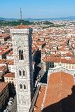 Aerial view of Giotto`s Campanile from the top of the Cathedral - Florence, Tuscany, Italy. Giotto Tower was built in 1334 by Giotto and completed in 1359 by stock image