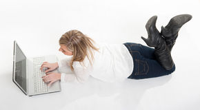 Aerial view of girl using laptop on the floor Stock Photography