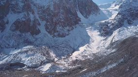 Aerial view of a glacier huge pieces of frozen ice and rock, top view stock video