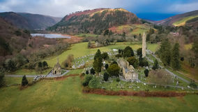 Aerial view. Glendalough. Wicklow. Ireland. Round tower and ruins of the monastic settlement of Glendalough. county Wicklow. Ireland stock photography