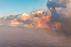 Aerial view of golden clouds lit by the evening sun over Florida, view from the aircraft during the flight. Stock Image