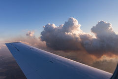 Aerial view of golden clouds lit by the evening sun over Florida, view from the aircraft during the flight. Stock Photography