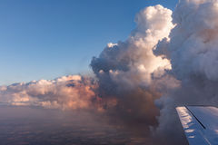 Aerial view of golden clouds lit by the evening sun over Florida, view from the aircraft during the flight. Royalty Free Stock Images