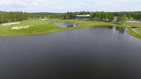 Aerial view on golf course with gorgeous green and pond stock video footage