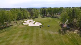 Aerial view of golfers playing on putting green. Professional players on a green golf course. Royalty Free Stock Photography
